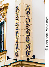 old pharmacy sign of letters on the facade