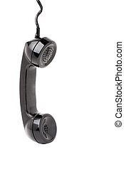 Close up of an old vintage phone handset hanging by the chord isolated over a white background.