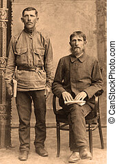 A vintage photo portrait from 1915 of Russian men.