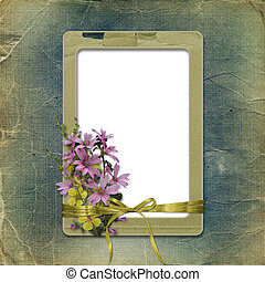 Old photo album with grunge frame and bunch of flowers for photos