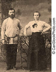 Antique family photo of long ago passed away relatives - circa 1909, Russia.