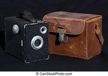 old photo camera on a black background