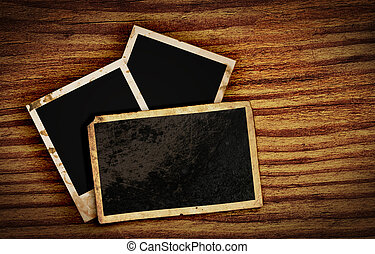 old photo frames on wood background