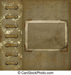 Old photoalbum with grunge frame for photos