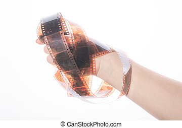 Old photographic film in the hand on white background