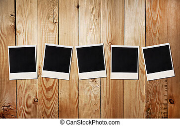 Old photos on a wooden background - Old photos on a wooden...