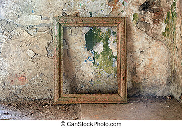 Old picture frame - Room in the ruins of a house with a...