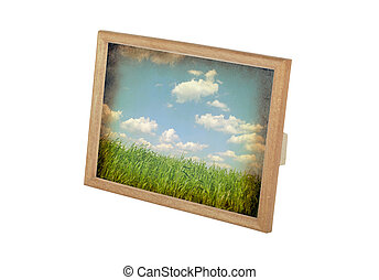 old picture in a frame on a white background