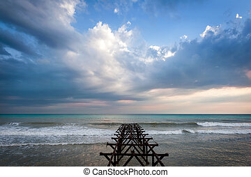 Old pier in the sea