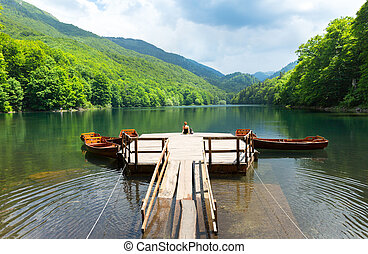 Old pier on mountain lake