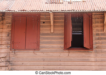 Old Pink Siding Wall Under Tin Roof
