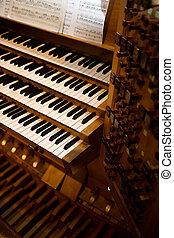 An old pipe organ keyboard in a church