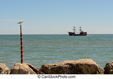 Old pirate ship near the coast - Old pirate ship and seagull...
