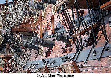 Old pirate ship on dockyard - retro style toned photo