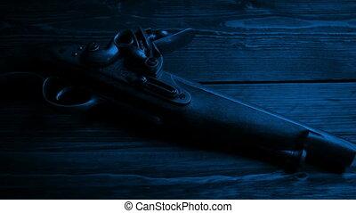 Old Pistol Gun On Table In The Dark - Old flintlock hand gun...