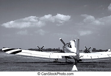 Old plane seen from behind, targeting blue sky, black and...