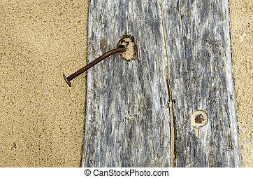 old plank on beach sand