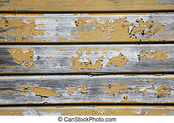 old planks with peeling yellow ochrebpaint