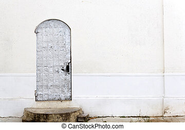 old plaster wall with a door