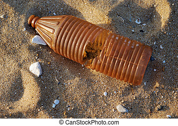 Old plastic bottle on the beach - Sunny morning with an old ...