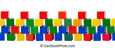 Old plastic color blocks - toys isolated on white background