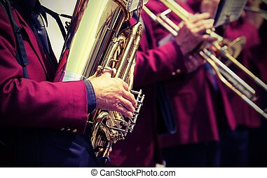 player of saxophone in the brass band