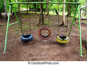 Old playground tire swing
