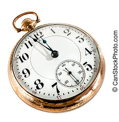 Antique golden pocket watch showing a few minutes to midnight isolated on white background. Concept of time, the past or deadline.