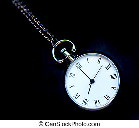 old pocket watch on black background