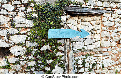 old pointer to the right on a background of a stone wall