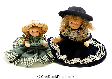 Old porcelain dolls on a white background