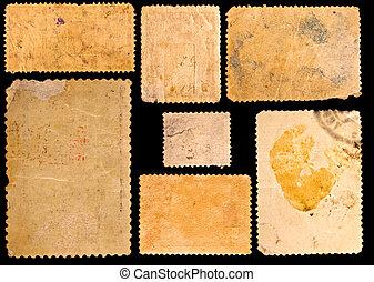 Old postage stamps border on black background