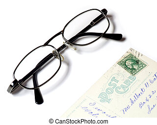 Old postcard and eyeglasses
