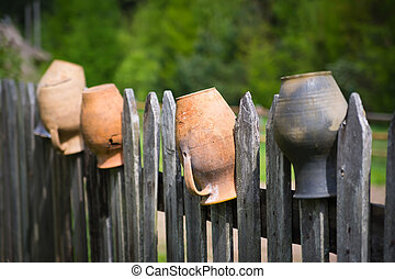 Old pot on the fence