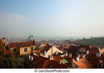 Old Prague roofs at autumn morning