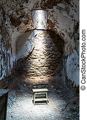 Old prison cell with little sunlight window