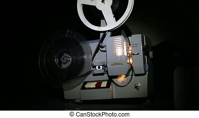 old projector showing film - dolly shot