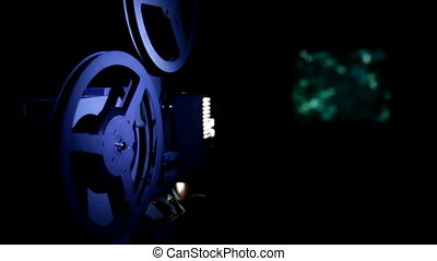 old projector showing film in dark