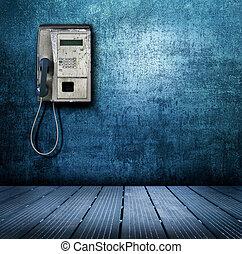 public phone on blue background