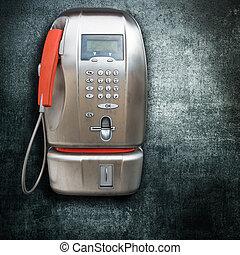 public phone on dark background