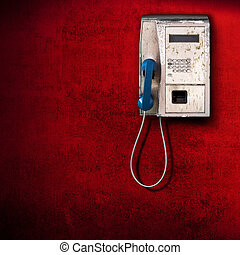 public phone on red background