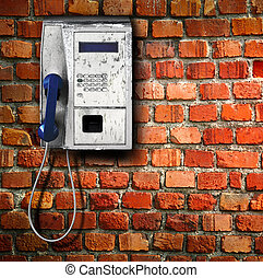 public phone on wall background