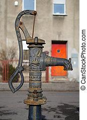 Old pump on street