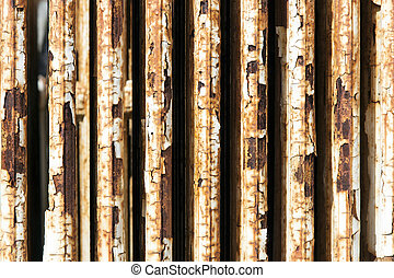 old radiator with cracked white paint and rust