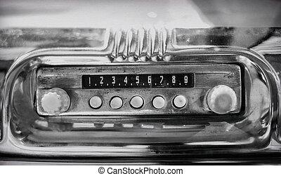 Old radio in retro car.