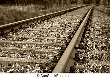 old railbed and rail tracks in sepia