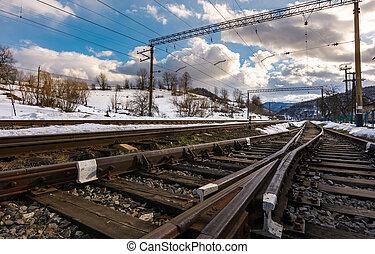 old railroad in winter mountain