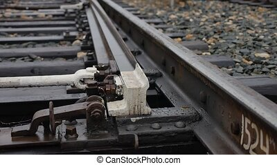 old railroad track switching rails way outdoors the road -...