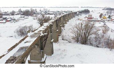 old railway aqueduct, stone bridge. snow, winter time....