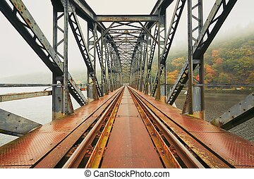 Old railway bridge in foggy morning